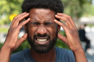image of man with headache